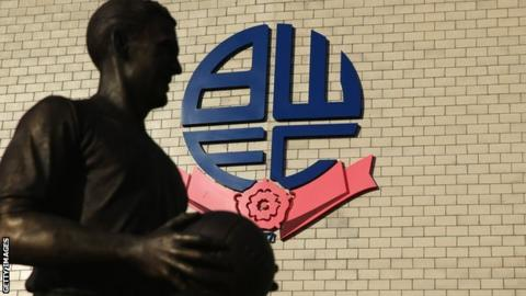 Nat Lotfhouse statue in front on Bolton's Stadium