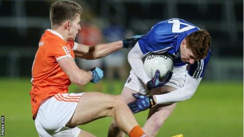 Armagh's Shea Heffron challenges Evan O'Carroll of Laois