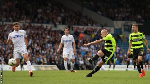 Aaron Mooy shoots Huddersfield ahead against Leeds at Elland Road