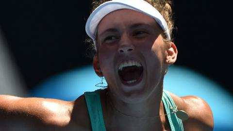 Elise Mertens celebrates against Elina Svitolina