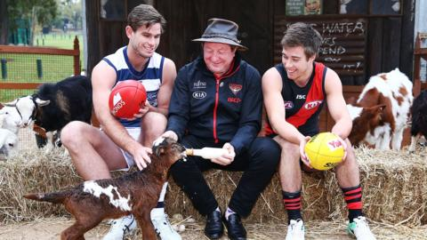 MELBOURNE, AUSTRALIA - MAY 14: Legend Essendon Bombers former coach Kevin Sheedy with Tom Hawkins of the Cats and Zach Merrett of the Bombers (R) during the Powercor Country Festival Launch at Melbourne Cricket Ground on May 14, 2018 in Melbourne, Australia. The Essendon Bombers play the Geelong Cats on the weekend to promote the Festival.