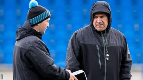 Glasgow Warriors coach Dave Rennie (right) takes training in the rain