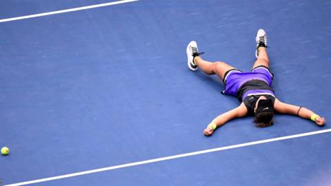 Flushing Meadows, New York, United States, September 7: Canada's Bianca Andreescu collapses to the floor after defeating Serena Williams to win her first Grand Slam (Photo by Danielle Parhizkan/USA Today/Reuters).