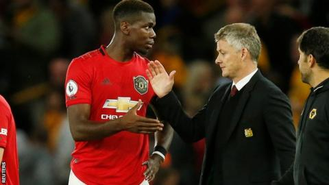 Paul Pogba (left) and Manchester United manager Ole Gunnar Solskjaer
