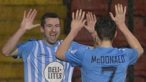 Stephen Murray celebrates with team-mate Conor McDoanld after scoring Warrenpoint's equaliser in the 1-1 draw away to Cliftonville