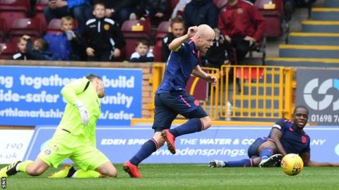 Hearts' Steven Naismith scored after Uche Izpeaku and Motherwell goalkeeper Trevor Carson challenged for the ball