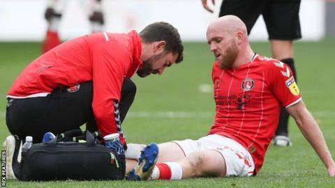Jonny Williams receives treatment for an injury