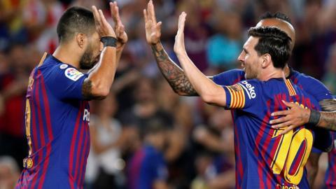 Luis Suarez (left) and Lionel Messi