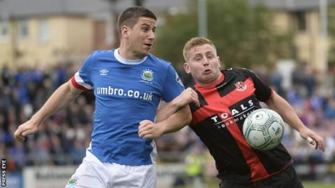Mark Haughey and David Cushley in action during Crusaders' 0-0 draw with Linfield in August