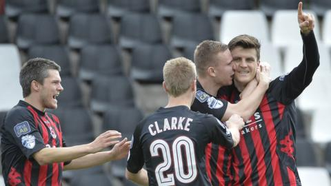 Diarmuid O'Carroll sets Crusaders on their way to a 5-0 hammering of Ballinamallard United and first league win of the season