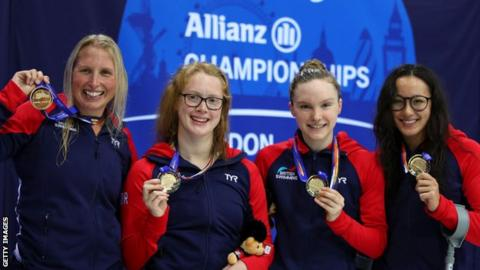 Great Britain's Stephanie Millward, Brock Whiston, Toni Shaw and Alice Tai pose with their gold medals after winning the women's 4x100m freestyle relay