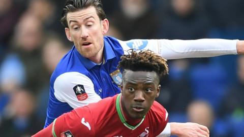 Swansea's Tammy Abraham and Wednesday's David Jones