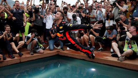 Monte Carlo, Monaco, 27 May: Red Bull's Daniel Ricciardo jumps into a pool as he celebrates winning the race REUTERS/Benoit Tessier TPX IMAGES OF THE DAY