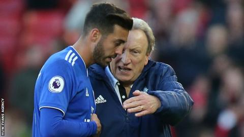 Midfielder Victor Camarasa talks tactics with Cardiff manager Neil Warnock