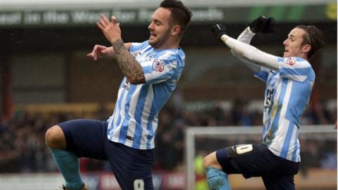 Coventry top scorer Adam Armstrong celebrated the first of his matchwinning treble with team-mate James Maddison