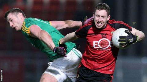 Down's Joe Murphy battles with Meath's Brian Power at Newry