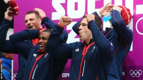 GB four-man bobsled crew watching other crews finish at the Sochi 2014 Winter Games