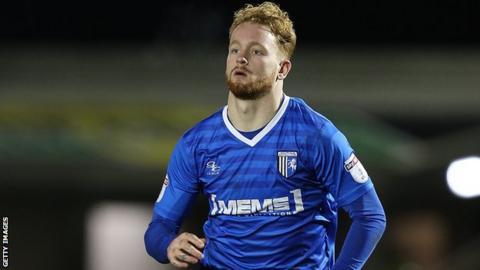 Connor Ogilvie in action for Gillingham