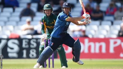 Kent batsman Heino Kuhn plays a shot while Nottinghamshire wicketkeeper Tom Moores looks on