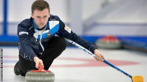 Scotland skip Bruce Mouat releases a stone