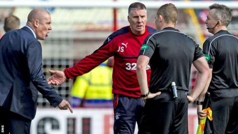 Rangers' Mark Warburton (left) confronts the officials at Pittodrie