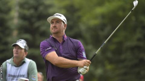 McDowell watches his tee shot at the sixth hole on Saturday