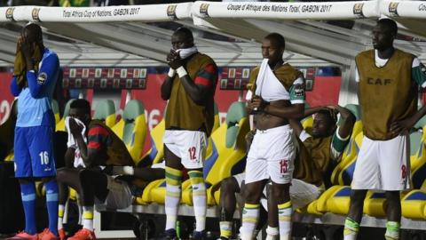 Senegal players react to losing to Cameroon