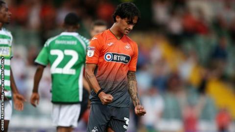 Yan Dmanda of Swansea City celebrates scoring a goal