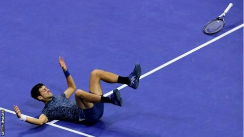 Novak Djokovic collapses to the court after winning the Us Open final against Juan Martin del Potro