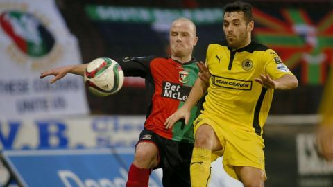 Barry Holland and David McDaid vie for possession during Glentoran's 2-0 victory over Cliftonville