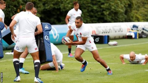 Owen Farrell Joe Marchant (centre) in action during training with England
