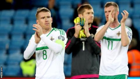 NI players acknowledge their 2,000-strong travelling support after the game