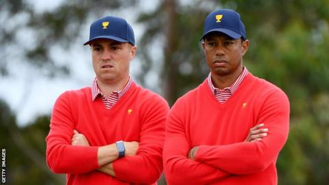 Justin Thomas (left) and Tiger Woods registered the only point for the US on the opening day of the Presidents Cup