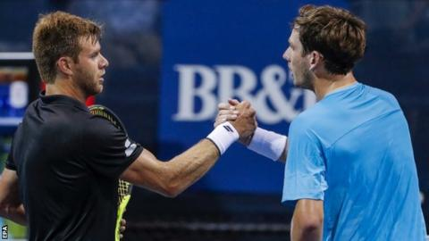 Ryan Harrison and Cameron Norrie shake hands