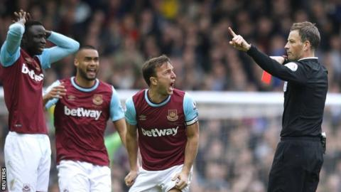 Mark Clattenburg sends off Cheikhou Kouyate (left)