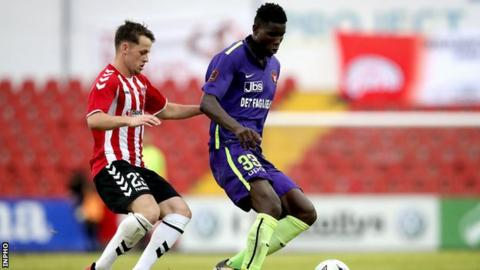 Striker Paul Onuachu holds of Derry's Ben Doherty