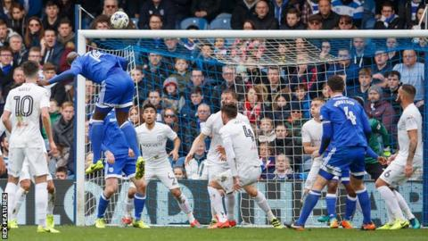 Cardiff defender Sol Bamba heads his side ahead against QPR