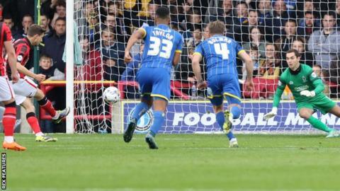 Shaun Miller scores a penalty