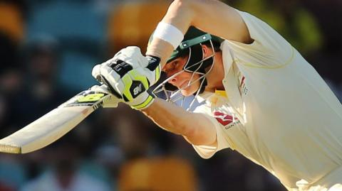 Australia captain Steve Smith plays a drive against England in the first Ashes Test
