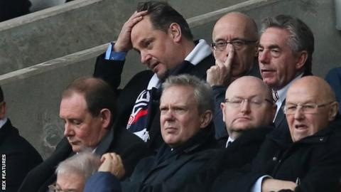 Bolton Wanderers CEO Dean Holdsworth watching their defeat by Preston