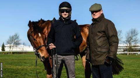 Ballyward is pictured with Willie Mullins, right, and his son Patrick who rode the the seven-year-old in his final race at Cheltenham on Tuesday