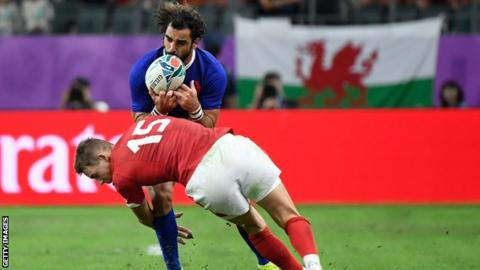 Rugby France wing Yoann Huget is tackled by Wales full-back Liam Williams during the 2019 World Cup quarter-final