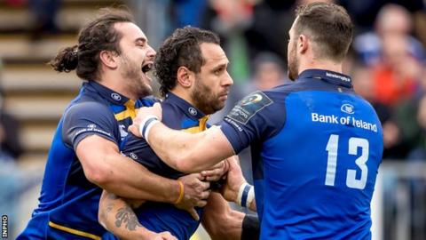 James Lowe and Robbie Henshaw congratulate Leinster try-scorer Isa Nacewa