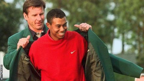 Nick Faldo presents Tiger Woods with his first Masters Green Jacket in 1997
