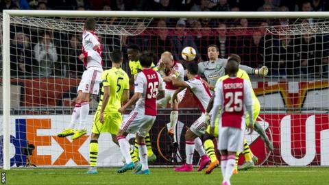 A free-kick by Lasse Schone evades everyone in the box and finds the net to give Ajax an equaliser against Celtic