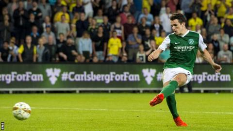 John McGinn side-foots his penalty but it is saved by Brondy keeper Frederik Ronnow