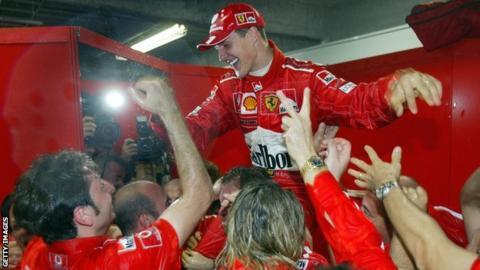 Michael Schumacher celebrates his sixth world title in 2003