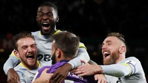 Derby's players celebrate beating Manchester United