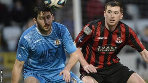 Portadown's Sean Mackle and Crusaders defender BJ Burns battle for possession