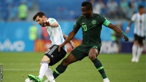 Lionel Messi and John Mikel Obi